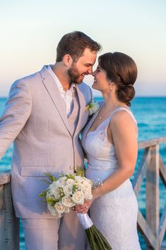 Capturing happiness! Bride and groom on the beach at their destination wedding in Playa del Carmen, Mexico. FOLLOW US for more beach wedding inspiration! (Wedding Photography by Fun In The Sun Weddings) https://funinthesunweddings.com/wedding-stories/jessica-harry-beach-wedding-vidanta-riviera-maya/