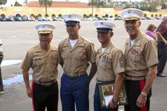 Brig. Gen. Daniel Yoo, left, the Marine Corps Recruit Depot San Diego commanding general, and Sgt. Maj. Rodolfo Arrieta, second from right, the 3rd Marine Aircraft Wing (Forward) sergeant major, and Maj. Gen. Gregg A. Sturdevant, right, the 3rd Marine Aircraft Wing (Forward) commanding general, stand with Pvt. Rudy Arrieta after his graduation from recruit training at Marine Corps Recruit Depot San Diego.