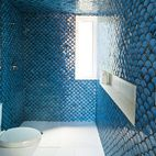 In the upper-level bathroom, tiles painstakingly fired by DeSimio cover the walls and ceiling.   Photo by Paul Barbera.