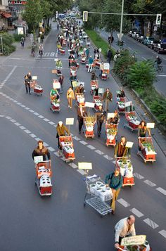parade of urban gardeners with their container crops, Berlin.