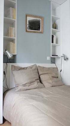 The bed leans against the column of the chimney camouflaged in a formwork painted in sky blue. On either side, niches with shelves exploit the existing recesses to form two small symmetrical libraries. Decor, Room, House, My Room, Home, Deco, Bed, Guest Bedroom, Bedroom