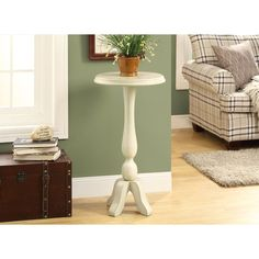 Brighten up your living space with this lovely white accent table. Featuring a tulip stem base and spacious table top, this charming accent table is the perfect addition to your home.