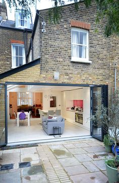 A colourful kitchen extension to a Victorian house in Crouch End An inflected glazed section of architectural glass was installed to maximise the light entering the existing dining room and three large roof lights were installed above the side return.