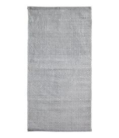 Nice, inexpensive rug as runner in entryway? -- Gray Rectangular rug in woven cotton fabric with a printed pattern at front.