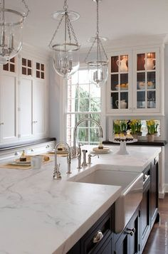 South Shore Decorating Blog: Manic Monday (But With Eye Candy) #3 // For a closer look at Hudson Valley Ligthing Hampton pendants, which hang above this beautiful marble island with a farmhouse sink, click here: https://www.hudsonvalleylighting.com/Item/252-PN-C1