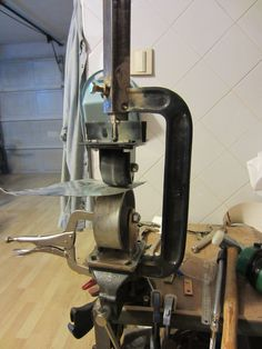 """Small English Wheel by KustomsbyKent -- Homemade small English wheel constructed from a 10"""" C-clamp, angle iron, steel and plastic casters, and threaded rod. http://www.homemadetools.net/homemade-small-english-wheel"""