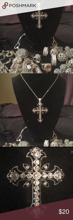 STAINLESS STEEL & AAA RATED CROSS NECKLACE If u want a large cross that packs a big punch, this is the 1 4 u. Made in SS it will never tarnish has antique filigree all over the cross w  black etching 19 AAA rated Russian CZ stones that give off an incredible brilliance 2 1/2 inches in length and 1 1/2 inches in width and 18 inches in length. There is no extender for this piece. The cross actually has a magnetic closure so u can remove it off of this chain & put it on any leather rope, velvet…