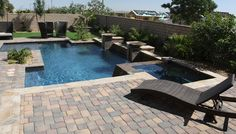 Lap pool with a custom spa and fountains residential for 701 salon sacramento