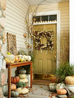Natural Autumn Entry with a Variety of Natural Colored Pumpkins and Gourds and Branches!  This is really lovely!