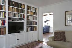 TV amidst full built-in bookshelves