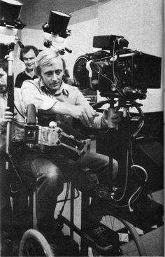 Steadicam operator Ray Andrew on the set of The Shining. Andrew stepped in to replace Garrett Brown for one month during production, while Brown fulfilled a previous commitment to operate Steadicam on Rocky II.   In this photo, Andrew is sitting in a specially modified wheelchair that was used for many shots on the film, including the shots following Danny racing around the Overlook on his Big Wheel.