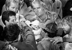 """Oct. 14, 1987: """"Baby Jessica"""" McClure was rescued 58 hours after falling down a 22-foot deep abandoned well outside of her day care center in Midland, Texas. Photo credit: Scott Shaw, The Odessa American"""