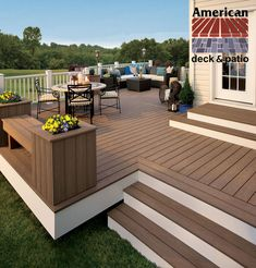 Trex Composite Decking. Built in Winchester, VA for the Trex Company. Low level deck allows for alternate design elements such as wide cascading steps, planter boxes, and custom benches. Notice use of mutiple material colors.