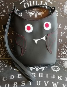 An adorable handbag, featuring a bat face and wings