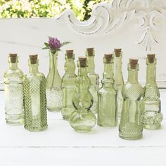 Gorgeous green glass bottles in miniature allow you great flexibility to fill in your centerpieces...or use them as wedding favors! #VintageGlassBottles #ShabbyChic