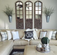 Rustic arch mirrors with hanging planters. Modern rustic farm house decor/style. light couch