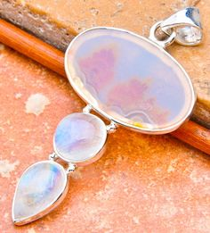Metaphysical Gifts, Cards, Wrap and Crystals | Life Is A Gift Shop - Dendrite Agate Oval-Shaped Cabochon with Round and Petal-Shaped Moonstone Cabochons set in Silver  , $94.00 (http://lifeisagiftshop.com/dendrite-agate-oval-shaped-cabochon-with-round-and-petal-shaped-moonstone-cabochons-set-in-silver/)