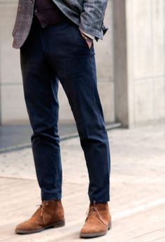 Brown desert boots, blue chinos