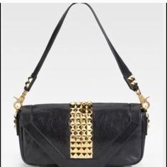 Tory Burch Gold Studded Bag! Like new 1000% authentic- THE Tory Burch Gold Studded handbag.  Mint condition just a smudge in the interior. Like new.  This bag can make any outfit super trendy.  Soft supple black leather with Gold stud hardware. Removable strap can take this bag from day to night.  Shoulder bag, clutch, handbag. Comes with dustbag.  This bag is the epitome of chic style and classy elegance! Tory Burch Bags