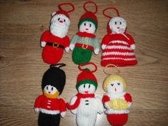 Four Hand Knitted Christmas Tree Decorations (Soldier/Santa/Snowman/Choirboy) - (made from a Jean Greenhowe pattern)