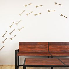 Flying Arrows Mount Wall Decal on wall behind sofa!!  http://wallsneedlove.com/collections/design-packs/products/flying-arrows-wall-decal