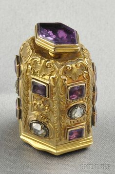 Antique 18kt Gold Gem-set Scent Bottle, c. 1840, the fine foliate bottle set with purple foil-back rock crystal and rose-cut diamonds, lg. 1 5/8 in.