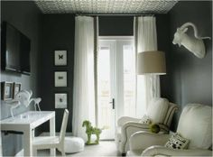 Love this grey.... a darker shade and check the ceiling! The brass brads on the white chairs and the green accents rock.