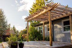 A modern but timeless cedar pergola with a cedar deck