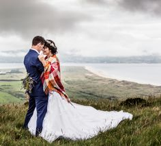 Bride and groom share a moment on the beautiful clifftop.