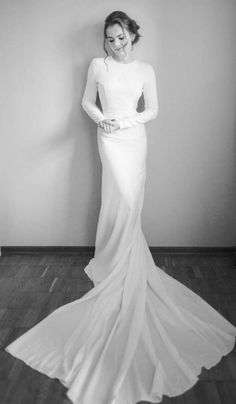 This wedding dress is about elegant simplicity and modern minimalist silhouette. It features open back cut, delicate buttons, long sleeves and train. Fabric is crepe with a stretchy satin lining. Silhouette: mermaid. Fabrics: crepe, satin lining. Closure: buttons.  Production time: 4-6 weeks.  Delivery time: 4-8 days via FedEx.  Rush orders: production time up to 10 days for additional 35% to original price.   You can order any dress from LiluBridal collection according to your personal…