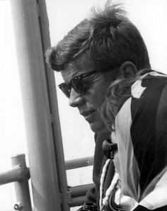 President John F. Kennedy and First Lady Jacqueline Kennedy watch the first race of the 1962 America's Cup from aboard the USS Joseph P. Kennedy, Jr., off the coast of Newport, Rhode Island- JFK...