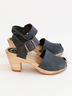 57f9bcaf4dd A classic mary-jane style clog with peep toe. Buckled ankle strap. 3