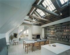Big bookcases, raw timber, and natural light