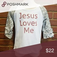 285e0c8f Jesus Loves Me Girls Ruffle Shirt White tee with quatrafoil sleeve design.  Words are in