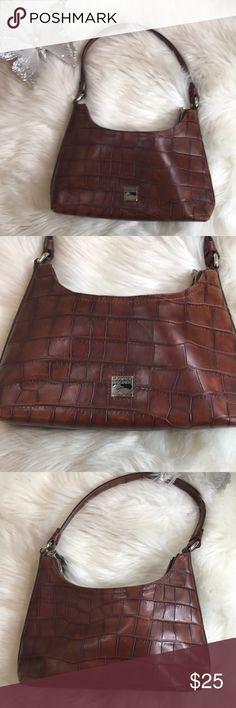"""Dooney & Bourke small brown purse. Dooney & Bourke brown purse. 100% authentic. Has some wear on bottom and corners. Otherwise very nice outside. In side has a couple pen marks . Otherwise very nice. Strap 9"""". Width 10"""". Length 5"""". Small shoulder purse. Dooney & Bourke Bags Shoulder Bags"""