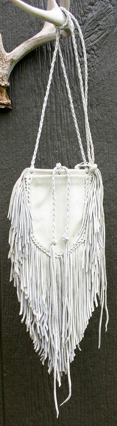 I created this Native influenced Medicine Bag from the hide up from soft, white, tanned top grain deerskin leather; no machine stitching! The double thick fringe is finely cut; not the Howdy Doody look. The bag ties are a 4 plait round braid and the body features 2 compartments for your sacred items &/or further decoration. The body measures 3.5 wide at the belly X 5 high. The fringe is 3.5 at the sides cascading to 8 long. The neck ties are 23 to the knot. Its now ready for your per...