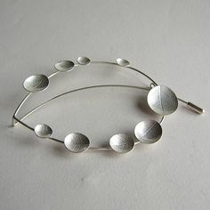 Sterling silver leaf outline brooch with leaf textured oval dishes around the outline by Catherine Woodall