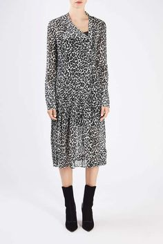This semi-sheer dress by Unique puts an elegant spin on animal print, from its…