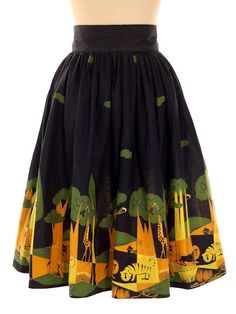 An awesome 1950s African animal + village scene novelty print skirt. #vintage #1950s #skirts #fashion #Africa