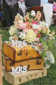 vintage suitcases as wedding decor / http://www.deerpearlflowers.com/vintage-bohemian-wedding-ideas/