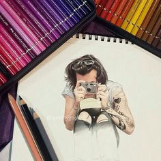 this is a drawing of the famous harry styles this photo belongs in this category because of all the fangirls this century