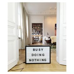 Busy doing nothing lightbox by Bxxlght . Decorate your home with inspiring quotes that change just as you do. What would your bxxlght lightbox say today? This lightbox is a product of scandinavian interior design and is featured in a scandinavian apartment. www.bxxlght.com