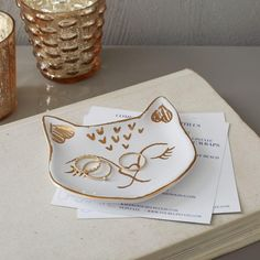 At your bedside or atop a chest, this pretty kitty is the perfect place to keep your rings, earrings and small jewellery.