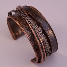Fabulous copper forging and design! I love the layering of texture and hammer te...