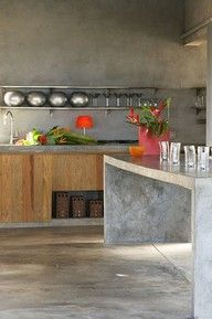concrete kitchen island. I like the finish of this polished concrete. Looks minimalistic and classy. Not sure how the crockery would fair at my house!