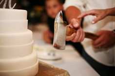 Cut the cake with a fireman's axe. You MUST do this!