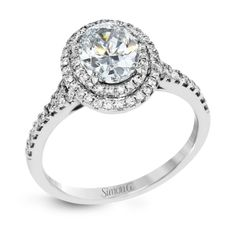 This beautiful, classic style setting features a double halo design built for an oval center stone. It contains .40 ctw of side diamonds.