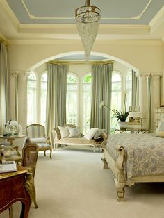 By Designer Tracy Morris. HGTV Designers Portfolio. This traditional Palm Beach estate bedroom was modeled after a 1920's boudoir. The style is a mix of regency and art deco, and the stunning focal point of the room is the elegant chandelier. The room was designed for relaxation, sleeping and writing. This room is so relaxing and the blues are so beautiful. I could really get lost in there.
