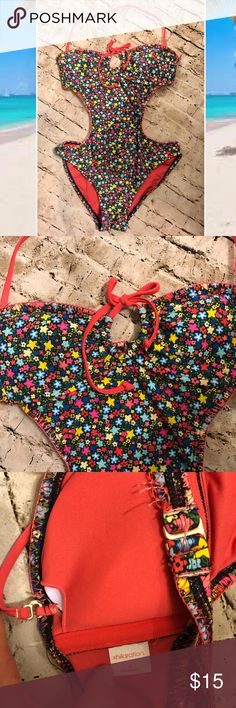 Floral Monokini size Medium halter or staples Like new condition. Blue, pink, red, yellow, green with pink stitching and straps. Super body flattering. Xhilaration Xhilaration Swim One Pieces