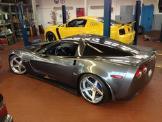 CORVETTE ZO6 MODIFIED END FORD MUSTANG IN GARAGE